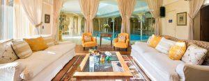 Bella-Coola-Verbier-Living-Room-Pool-View-1-300x117